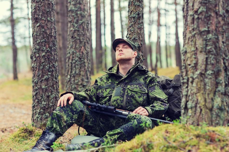 military man sleeping in the woods